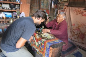 In the hill town of X, Dave and I received blessings at the local monastery.