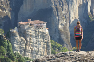 Noelle posing with Roussanou Monastery in the background.