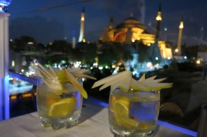 Overlooking the Hagia Sophia while sipping gin martinis topped with what seems to be a full pear.