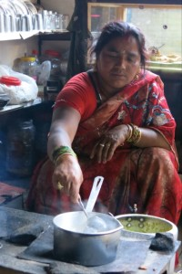 A Hindu woman in X invited us into her home as she prepared our tea.