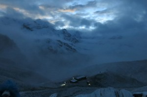 Just as first light started to break behind the mountains. You can see our digs at high camp below.