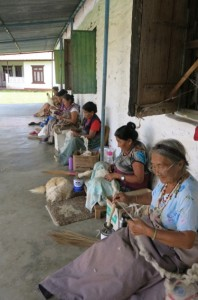 A group of friendly women preparing wool at a Tibetan Refugee Camp in Pokhara