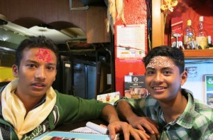 "Locals at our favorite restaurant observing the Hindu festival traditions with the forehead mark or ""tikka,"" this one made up of colored powder and rice."