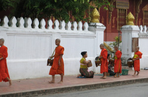 A few of the younger monks collecting alms.