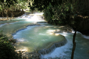 Emerald green waters at Kuang Si waterfalls.