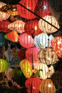 Silk and paper lanterns light up the streets at night.