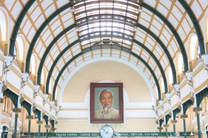 The inside of the Post Office showcases a long, domed roof and tiled floors, with a portrait of Ho Chi Minh at the center of attention.