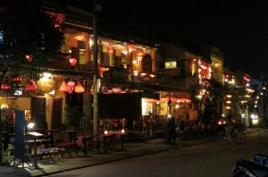 The waterfront on the opposite side of the bridge was filled with restaurants and bars, lit with lanterns.