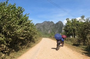 Locals biking between villages.