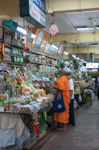 See? Monks are just like the rest of us. Indecisively trying to choose what to buy at the market.