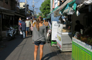Exploring a morning market in search of our next meal.