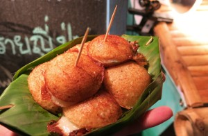 And Dave's new favorite obsession: Ka-Nom-Krok – a Thai dessert made from flour, coconut milk, sugar, and salt, topped with sliced spring onion and packaged in a banana leaf. The nonsense above aside, it was basically a deep fried pudding bite.
