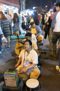Live music in the middle of the street at the Saturday Market Walking Street.