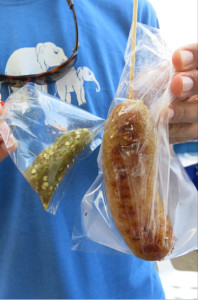 Rice sausage and green chili sauce, served fresh in plastic bags.