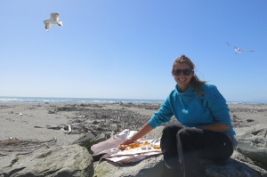 Eating/warding off the dive bombing seagulls.
