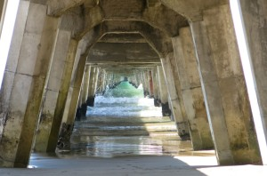Water rushing through the wharf underbelly.