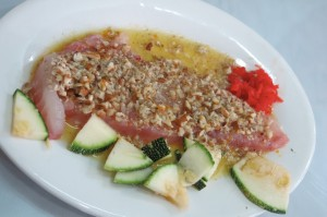 Tiradito is a Peruvian dish of raw fish, similar to sashimi and carpaccio, served in a spicy sauce.