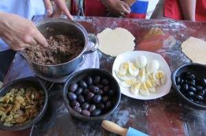 Ingredients for our empanadas -- hardboiled egg, beef and olives.