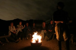 Campfire singing with new friends.
