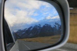Leaving the park, putting Mt. Cook in the rearview... err, sideview... mirror.